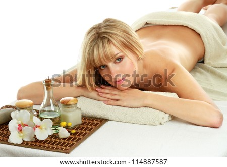 Young blonde woman at spa procedure - stock photo