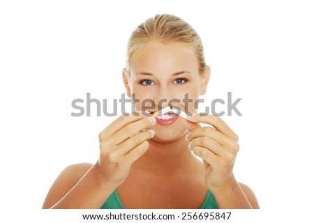 Young blonde woman breaking cigarette - stock photo