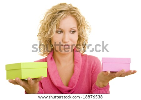 Young blonde woman comparing two gift boxes - stock photo
