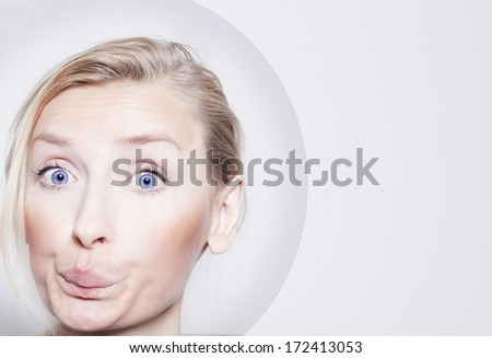 Young blonde woman making funny face. - stock photo