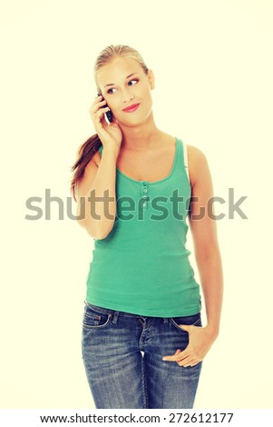 Young blonde woman talking on the phone - stock photo