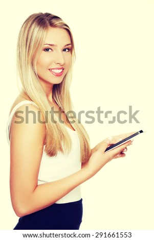 Young blonde woman with a tablet - stock photo
