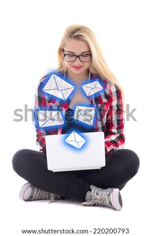 young blondie woman sitting with laptop and sending messages isolated on white background - stock photo