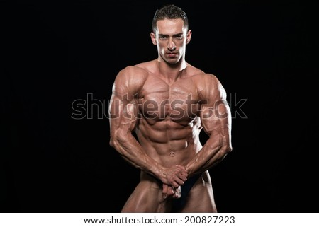 Young Bodybuilder Flexing Muscles - Isolate On Black Background - Copy Space - stock photo