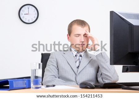 young bored businessman sleeping in his office - stock photo