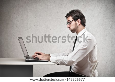 young bored businessman working - stock photo