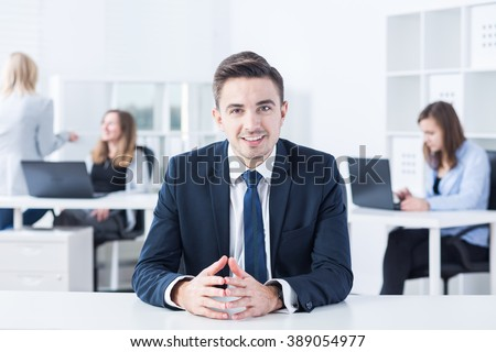 Young boss is talking with his future worker  - stock photo
