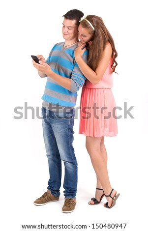 Young boy and girl with a smartphone app using - stock photo