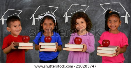 Young boy and girls holding books before school - stock photo
