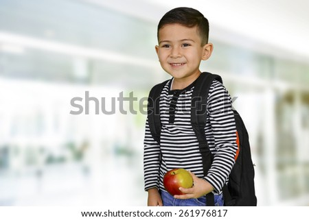 Young boy at school who is smiling - stock photo