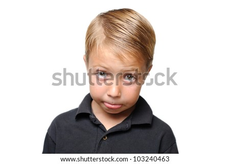 Young Boy Begging with Big Eyes. Young boy making a sad face at the viewer and attempting to get what he wants by using his big eyes and sad expression. - stock photo