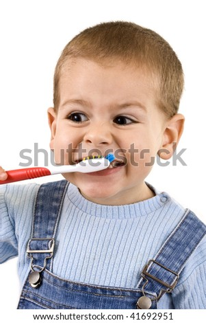 Young boy brushing his teeth with toothbrush, isolated in white - stock photo