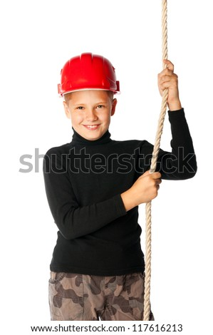 young boy builder in helmet holding a rope - stock photo