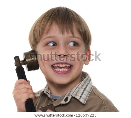 young boy calling by old, vintage phone - stock photo