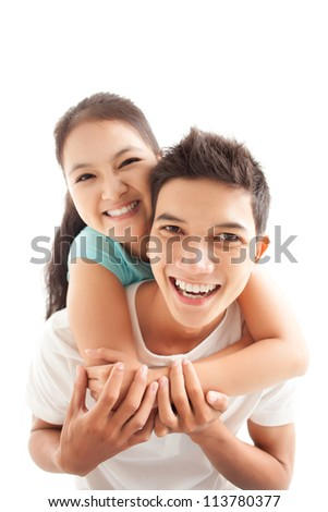 Young boy carrying his girlfriend on shoulders - stock photo