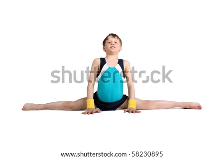 young boy doing the splits - stock photo