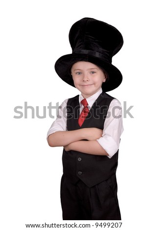 Young boy dressed as a magician with a hat over a white background - stock photo