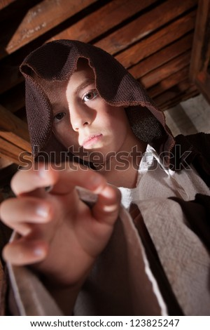Young boy dressed as a science fiction character reaching out - stock photo