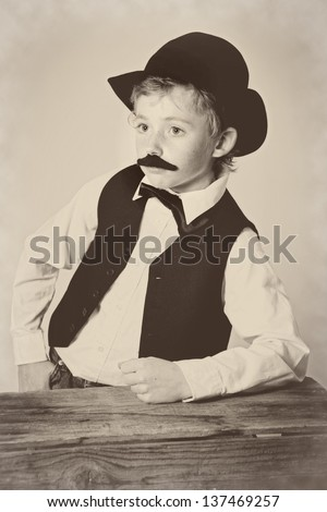 Young boy dressed as a western bartender; vintage - stock photo