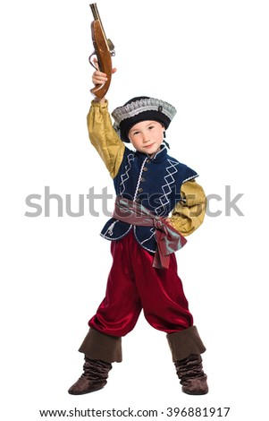 Young boy dressed as pirate posing holding the gun over his head. Isolated on white - stock photo