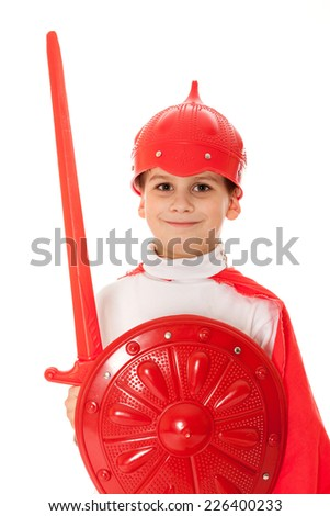Young Boy Dressed Like a knight holding a sword and shield isolated on white - stock photo