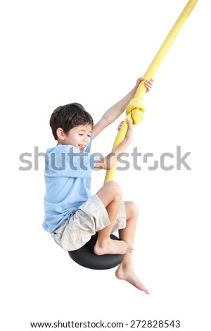Young boy enjoying on balancing activity  isolated on white background. - stock photo