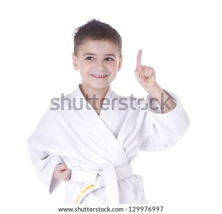 Young boy fighter in kimono with finger up isolated on white background - stock photo