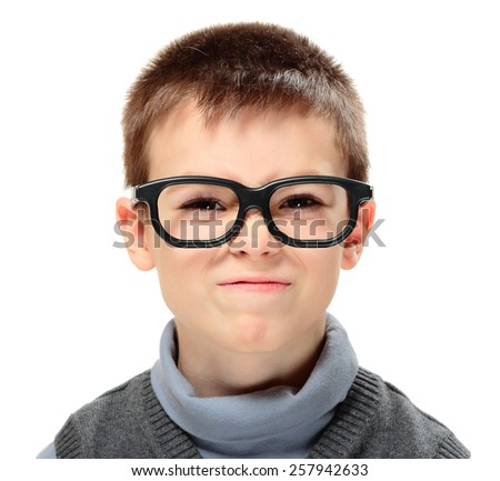 Young boy frowning face isolated on white background - stock photo