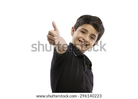 Young boy giving a thumbs up - stock photo