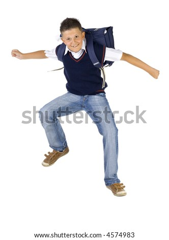 Young boy having fun. Jumping in the air with backpack. Looking at camera. Isolated on white in studio, front view - stock photo