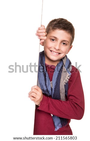 Young boy holding a white placard over white - stock photo