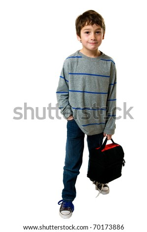 young boy holding his lunch bag for school - stock photo