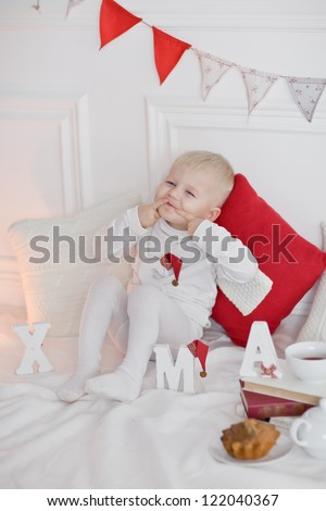 Young boy in christmas at home - stock photo