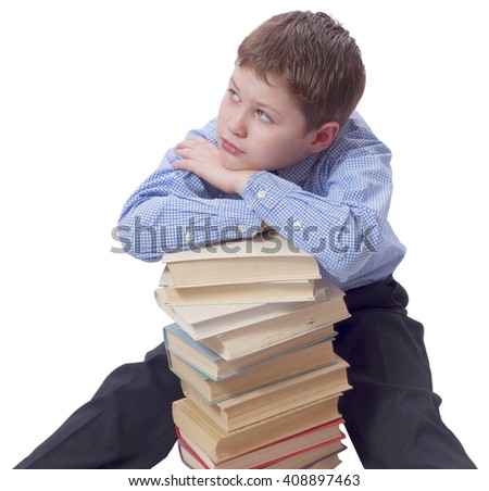 Young boy in classic  dress sitting with heap of books - stock photo