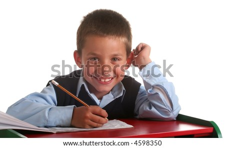 Young boy in elementary/primary school uniform working - stock photo