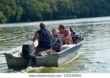 young boy in fishing boat - stock photo
