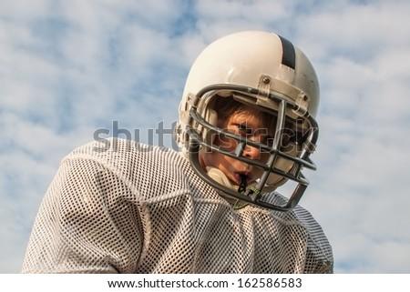 Young boy in football helmet - stock photo