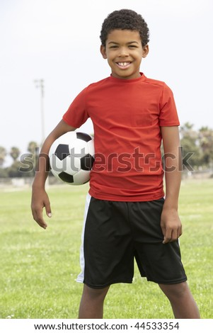 Young Boy In Football Team - stock photo