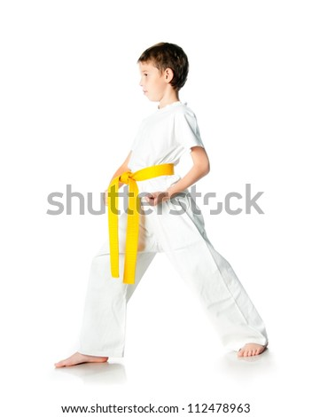 Young boy in kimono with yellow belt  on a white background - stock photo