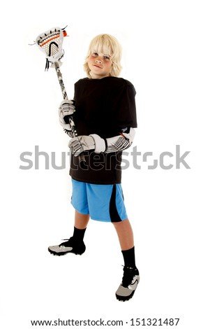 Young boy in lacrosse outfit with stick - stock photo