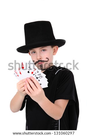 Young boy in magician costume with cards - stock photo