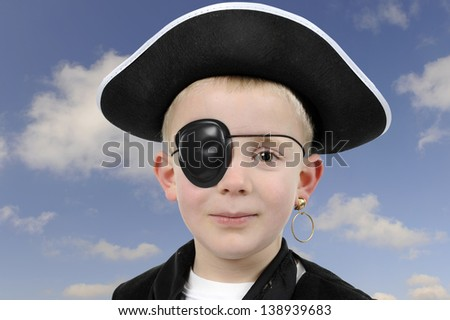 young boy in pirate costume, isolated on white background - stock photo