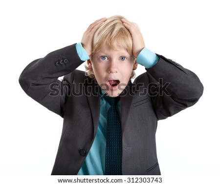 Young boy in suit clasped his head in horror, looking at camera, isolated on white background - stock photo