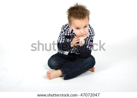Young boy is looking disappointed. - stock photo