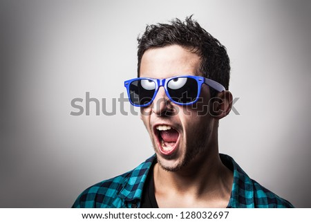 Young boy is shouting very loud. Let's shout! - stock photo