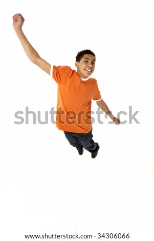 Young Boy Leaping In Studio - stock photo