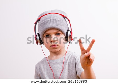 Young boy listen to music with a smartphone - stock photo