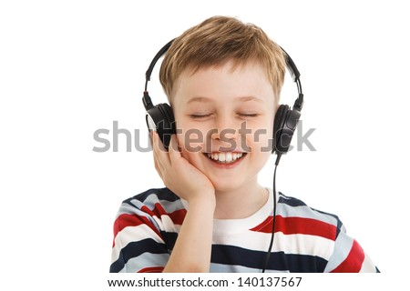 young boy listening a music in a headphones isolated - stock photo