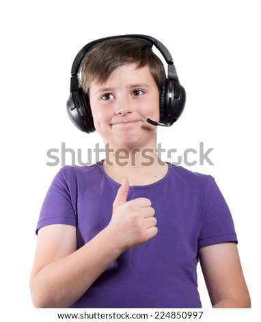 young boy listening a music in a headphones, isolated on white background - stock photo