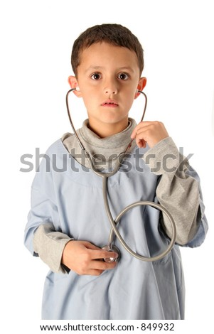 young boy listens to his heart in blue scrubs isolated on white - stock photo